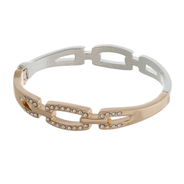 Silver and gold tone bangle bracelet with a hinge closure, and a linked design.