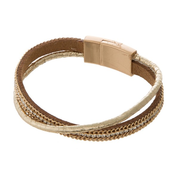 Faux leather bracelet with rhinestone accents, chain details and a magnetic closure.