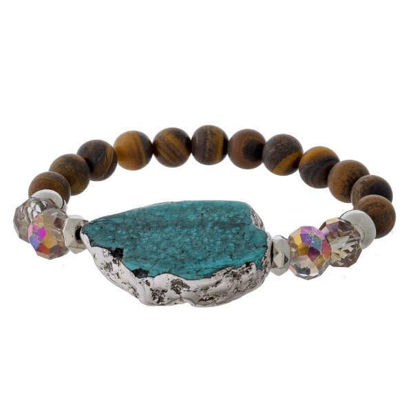 Natural stone beaded stretch bracelet with a turquoise focal.
