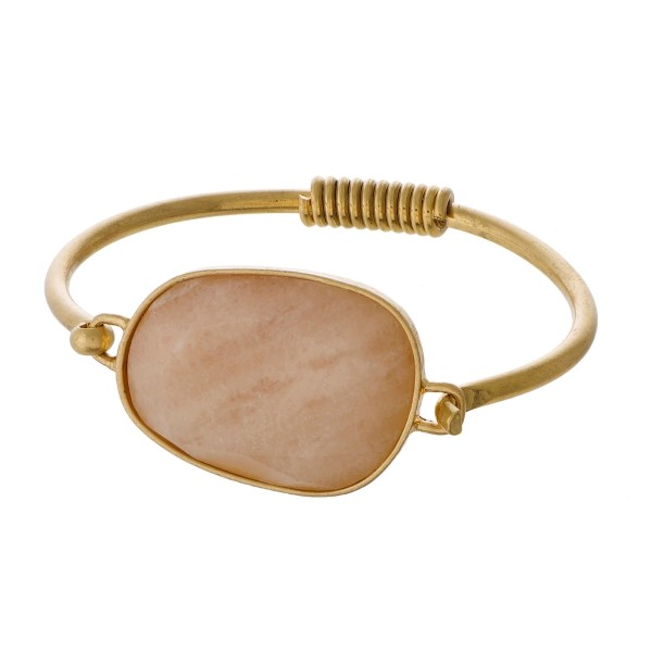 Burnished gold tone cuff bracelet with a natural stone focal.