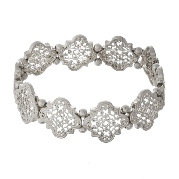 Metal stretch bracelet with quatrefoil design.