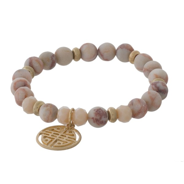 Natural stone bracelet with metal boho charm.