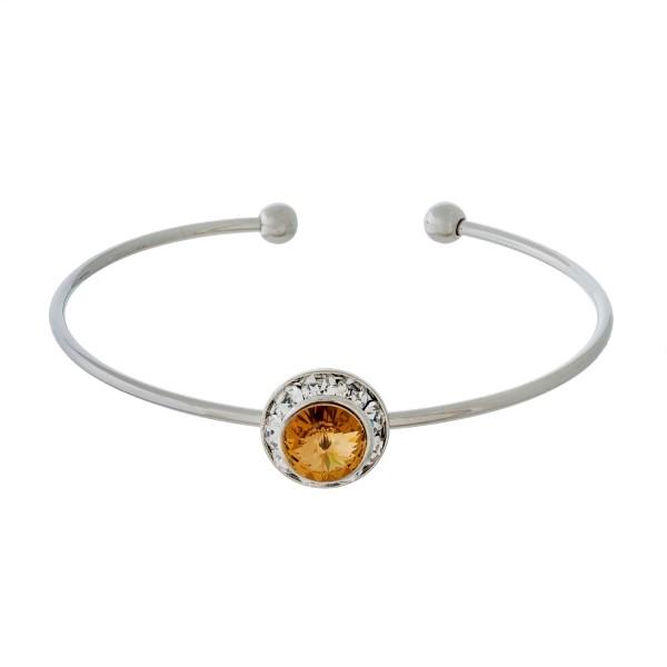 Silver tone, cuff bracelet with a Swarovski crystal focal.