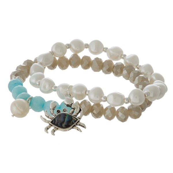 Two bracelet set with faceted beads, sea life charm, and pearl accents.