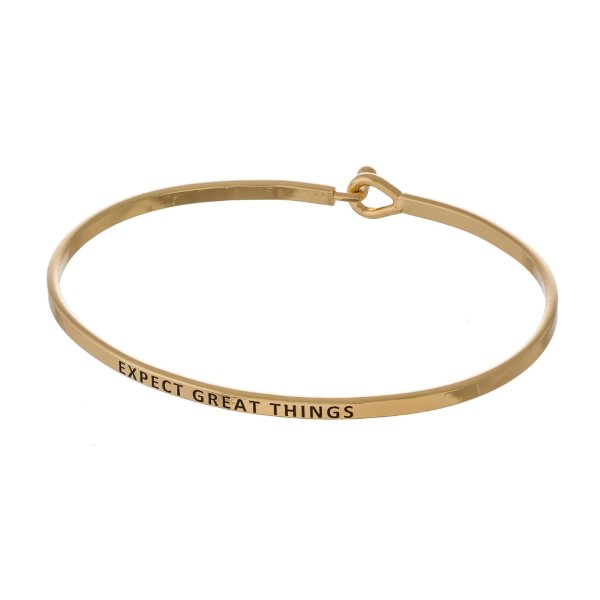 "Metal bracelet with engraved message, ""Expect Great Things."""