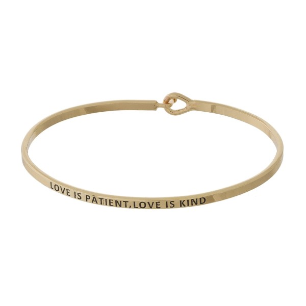 "Metal bracelet with engraved message, ""Love is Patient, Love is Kind."""