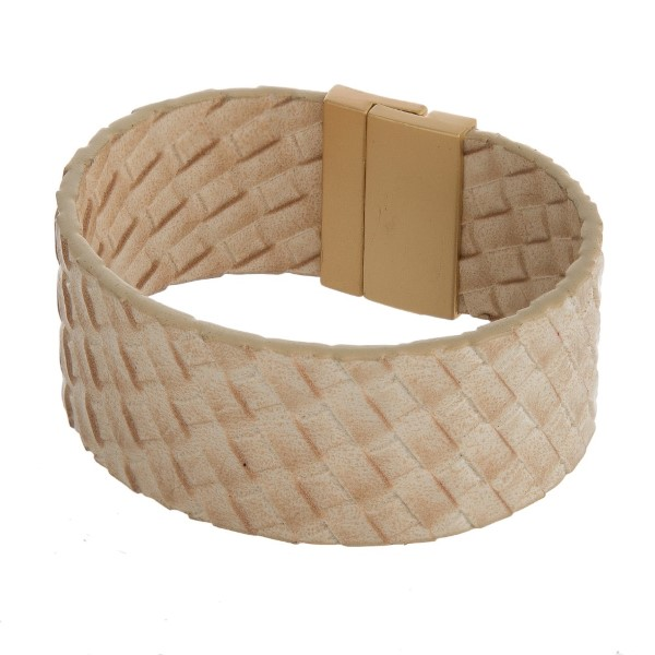 Leather, magnetic bracelet with a weave pattern.