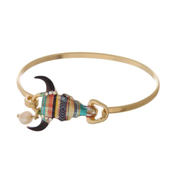 Burnished metal, bangle bracelet with a steer head focal.