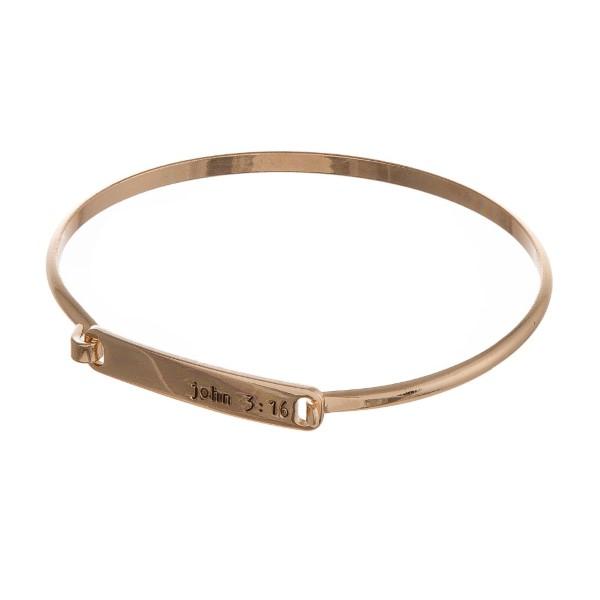 "Metal bracelet stamped with ""John 3""16."""