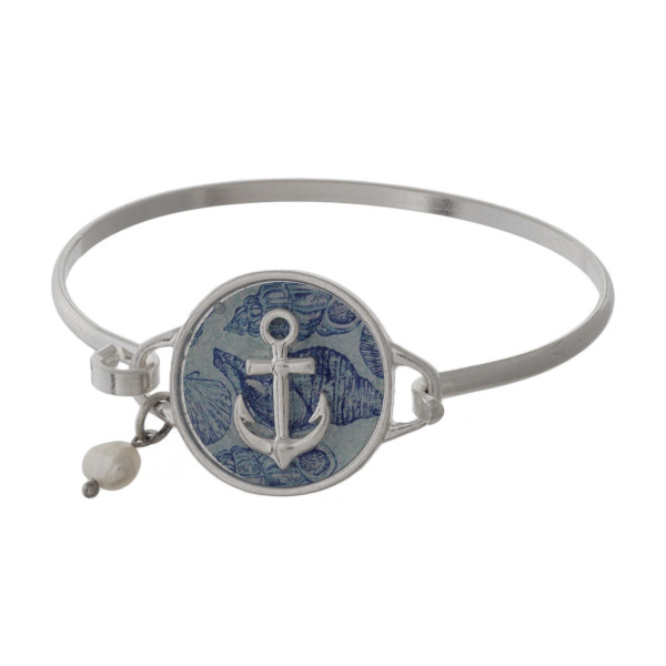 Metal latch bracelet with sea life focal.