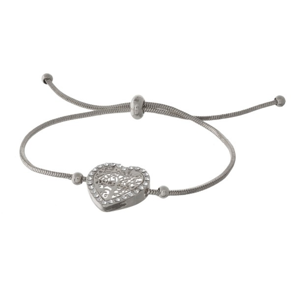 Adjustable metal bracelet with a filagree detail.