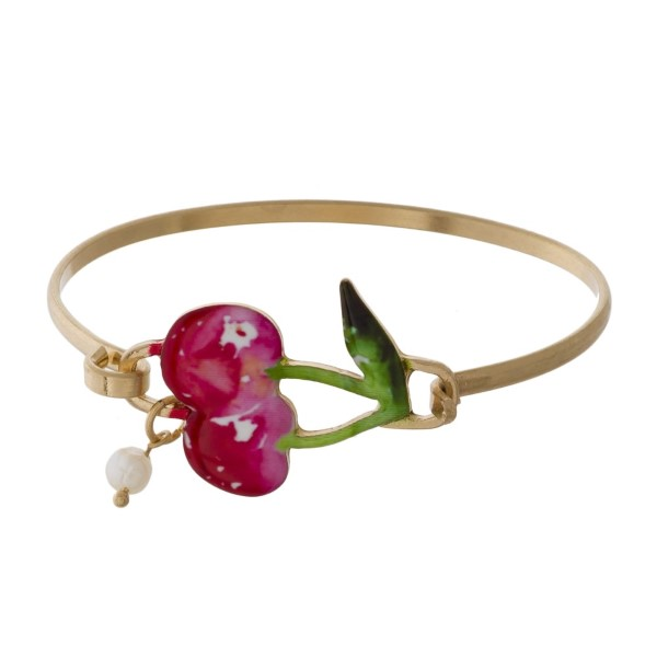 Metal latch bracelet with tropical focal.