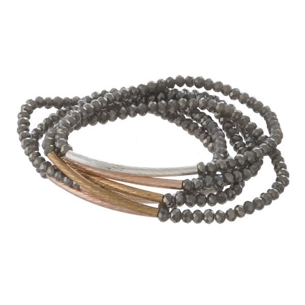 Faceted bead bracelet set with metal details.