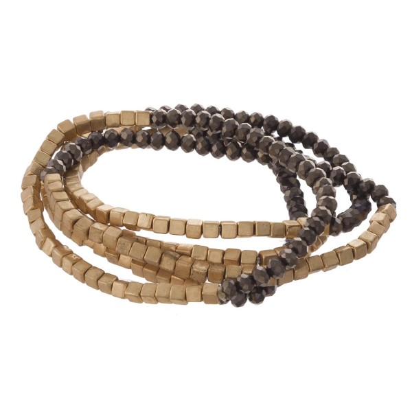 Faceted bead bracelet set with gold bead accents.