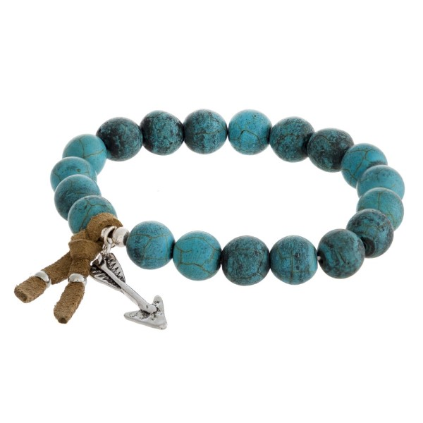 Beaded stretch bracelet with arrow charm and faux leather tassel.