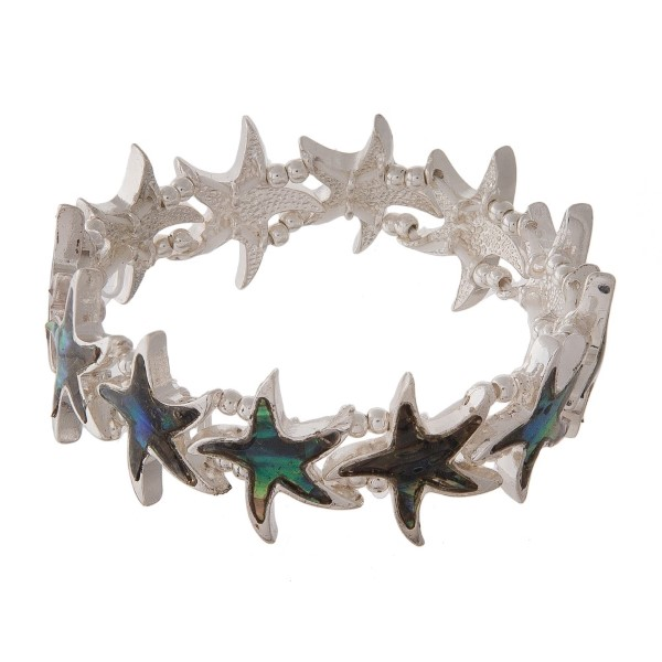 Silver tone stretch bracelet with sea life detail.
