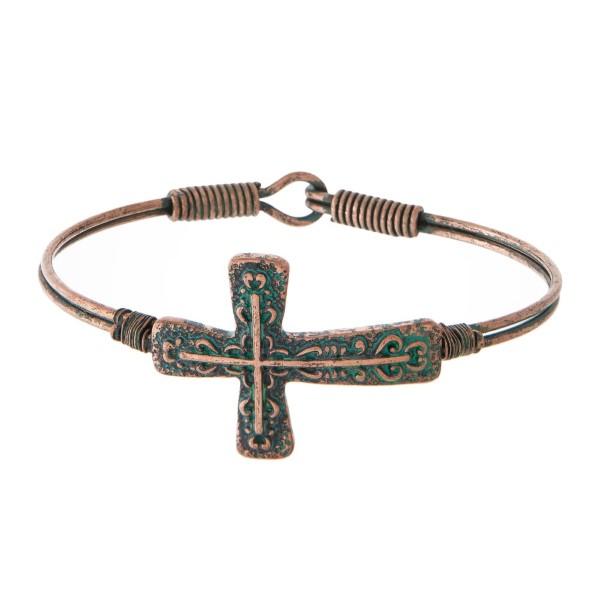 Metal bracelet with cross focal.