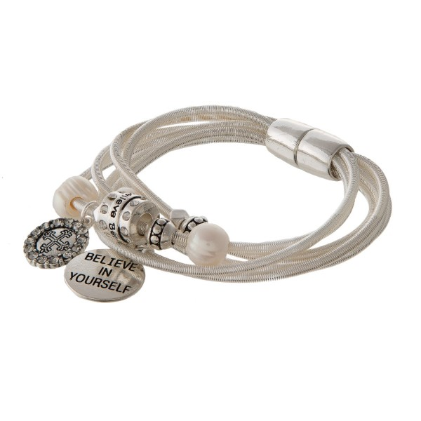 Metal cord bracelet with magnetic closure stamped with Believe in Yourself.