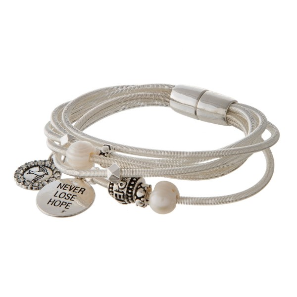 Metal cord bracelet stamped with Never Lose Hope.