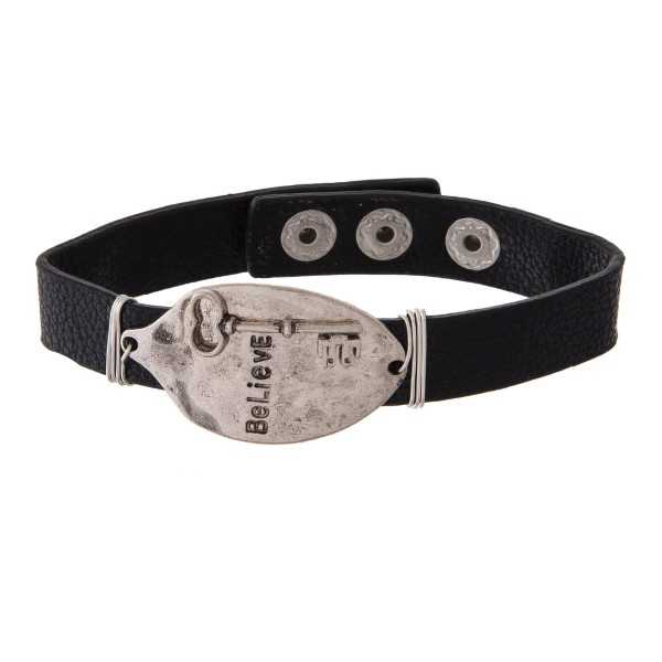 Faux leather bracelet with spoon focal stamped with Believe.