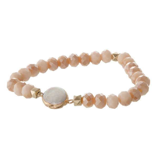 Faceted bead stretch bracelet with pearl detail.