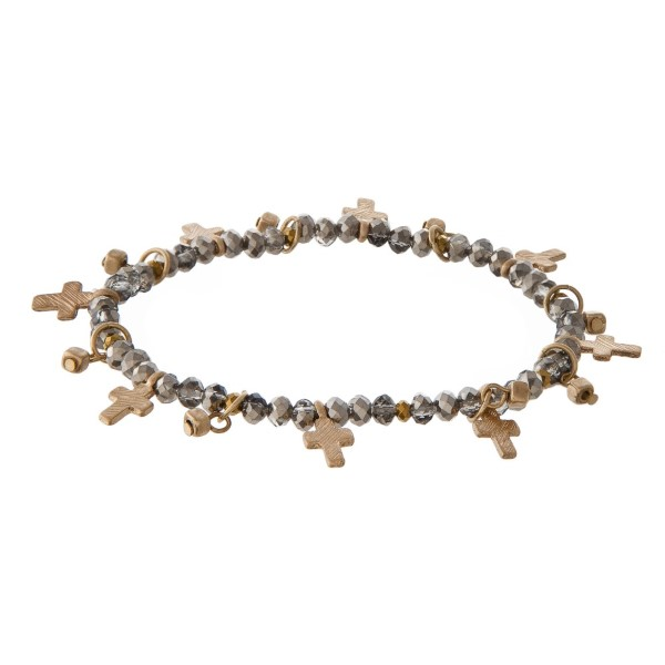 Faceted bead stretch bracelet with cross charms.
