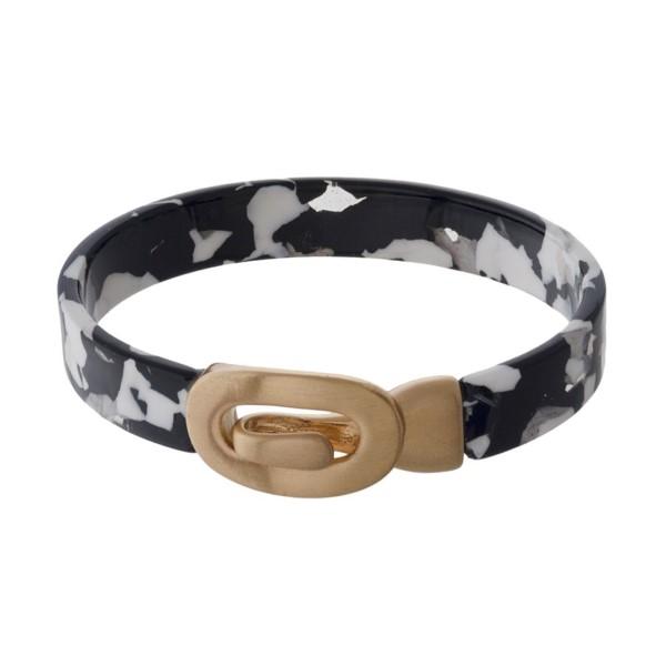 Acetate bangle bracelet with latch closure.