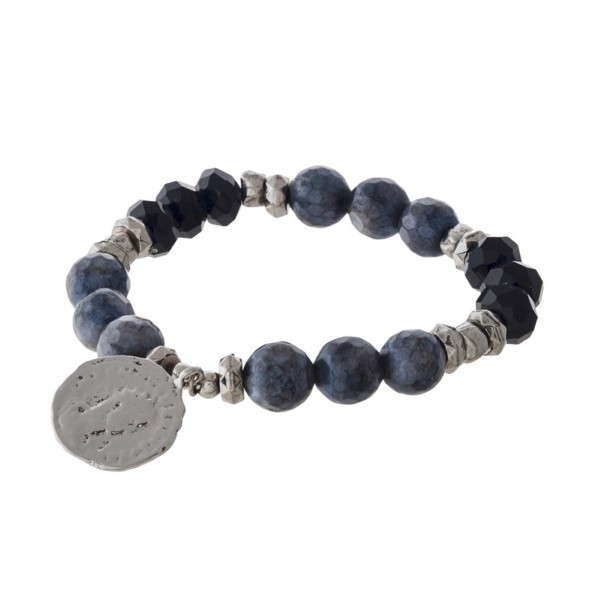 Stretch bracelet with natural stone and faceted beads and coin detail.