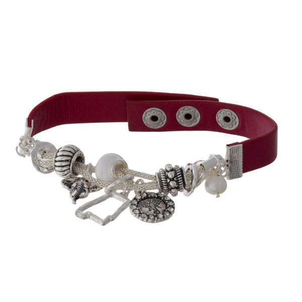 Faux leather bracelet with collegiate charms.