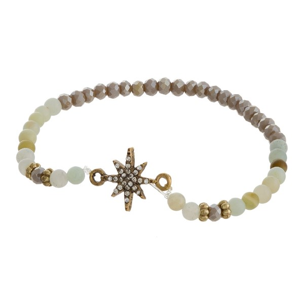 Beaded stretch bracelet with star detail.