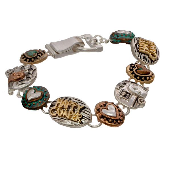 Metal bracelet with happy camper detail.