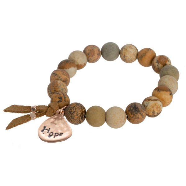 "Beautiful natural stone stretch bracelet with ""Hope"" message. Approximate 3"" in diameter."