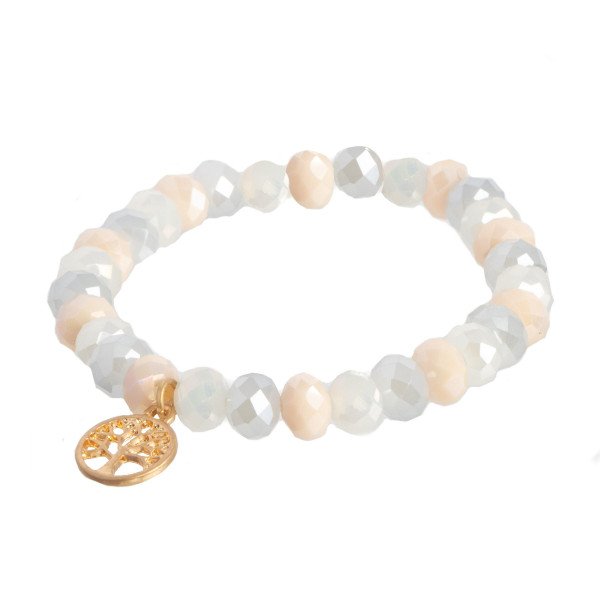 Faceted bead stretch bracelet with a tree of life charm.