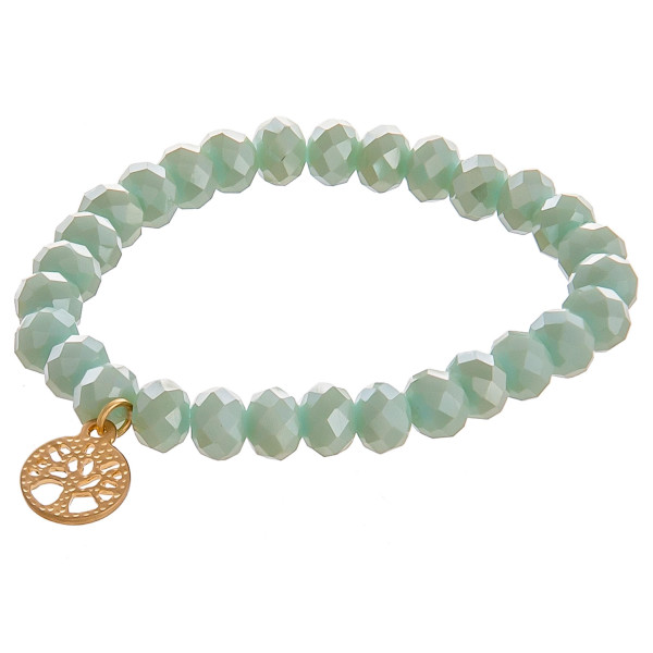 """Gorgeous mint beaded stretch bracelet with tree of life symbol. Approximate 8"""" long, 3"""" diameter un-stretched. .5"""" pendant."""