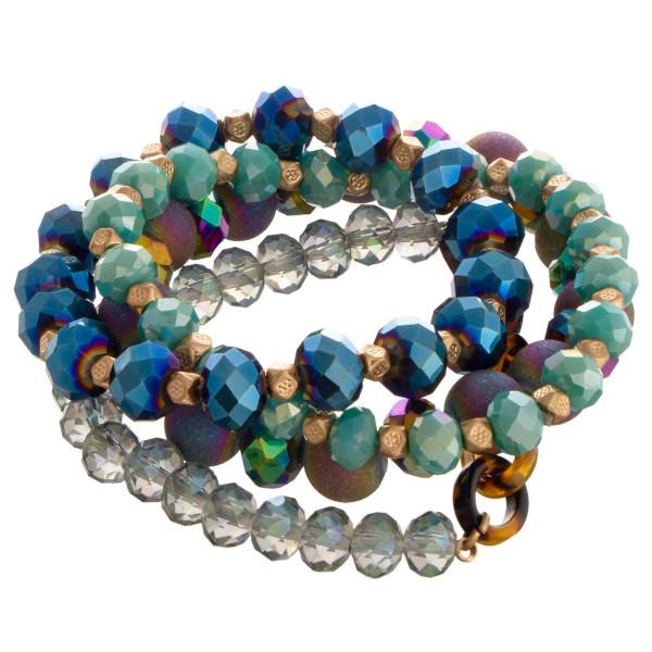 Beaded stretch multi bracelet set with tortoise shell link focal.