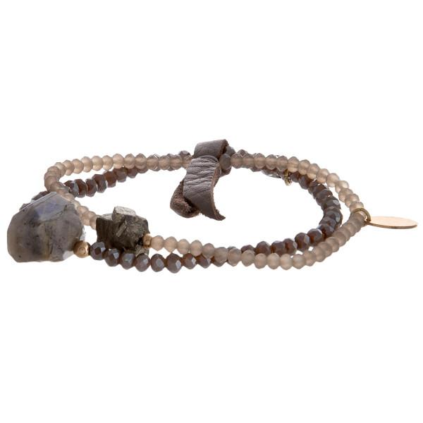 Beaded boho bracelets with crystal detail.