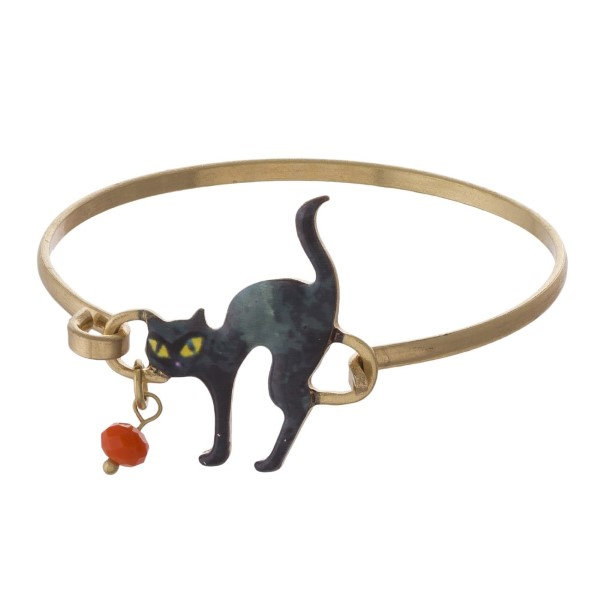 Gold tone metal bracelet with cat focal.