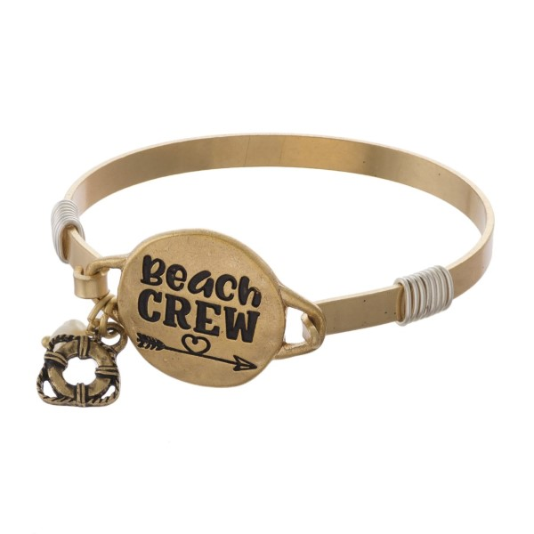 Metal bracelet stamped with Beach Crew.
