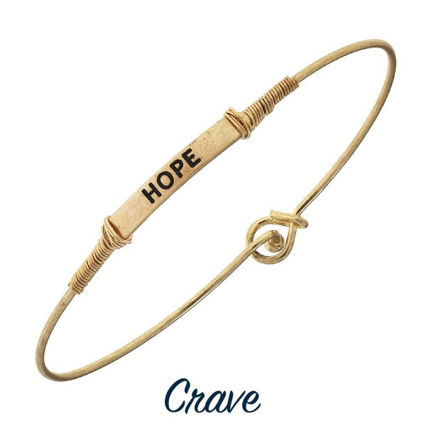 Wrapped wire bangle bracelet with bar focal and inspirational message.