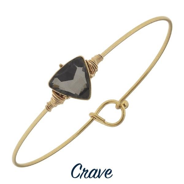Metal bracelet with rhinestone focal.