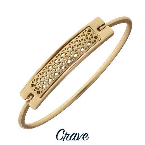 Metal bracelet with filigree bar focal.