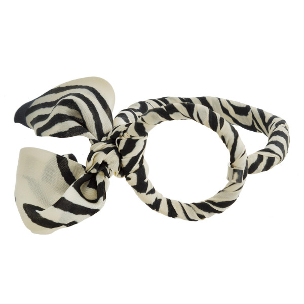 Metal bracelet with silky fabric detail.
