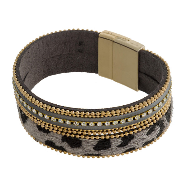 Faux leather magnetic cuff bracelet with animal print and jeweled detail.
