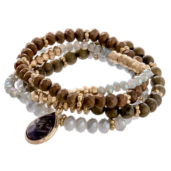 """Nice beaded and natural stone stretch bracelet. Approximate 3"""" in diameter."""