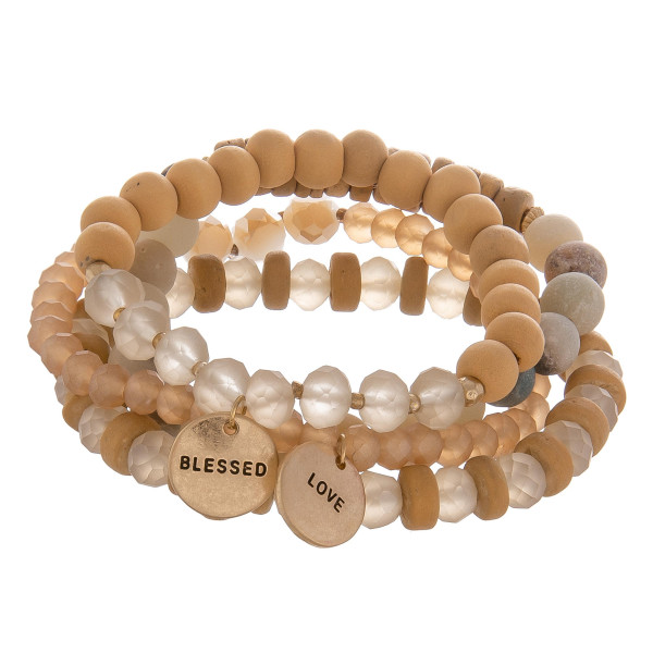 "Multi layered bracelet with natural stone, wood and bead detail. With message charms. Blessed/Love. Approximate 6"" in length."
