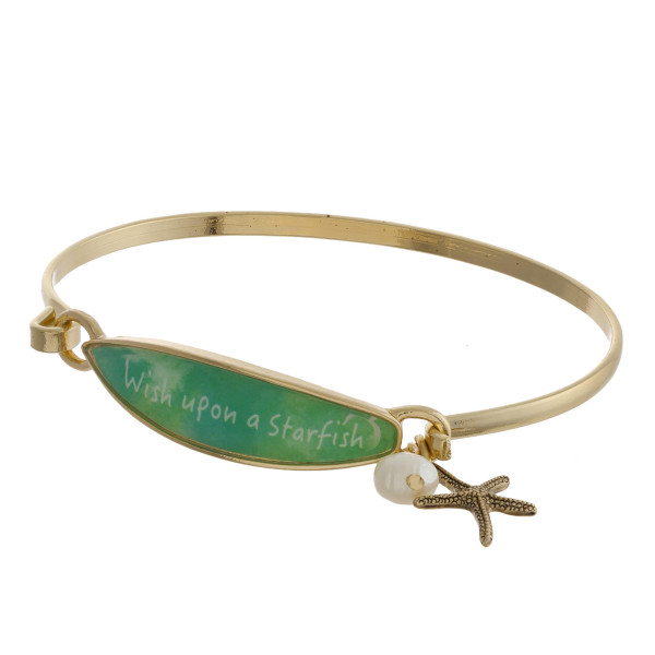 """Metal cuff bracelet with charms and message. Approximate 2"""" in diameter."""