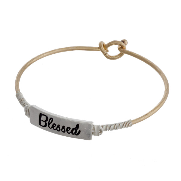 """Metal bracelet with engraved message. Approximate 2"""" in diameter."""