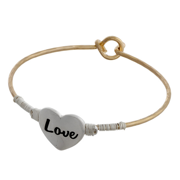 "Two tone bangle bracelet with wire wrapped heart focal engraved with ""Love"". Approximately 2"" in diameter. Fits up to a 4"" wrist."