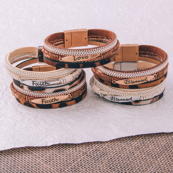 """Three layered faux leather bracelet featuring a metal """"Blessed"""" engraved focal, animal print and a magnetic clasp closure. Approximately 2.75"""". Fits up to a 6"""" wrist."""