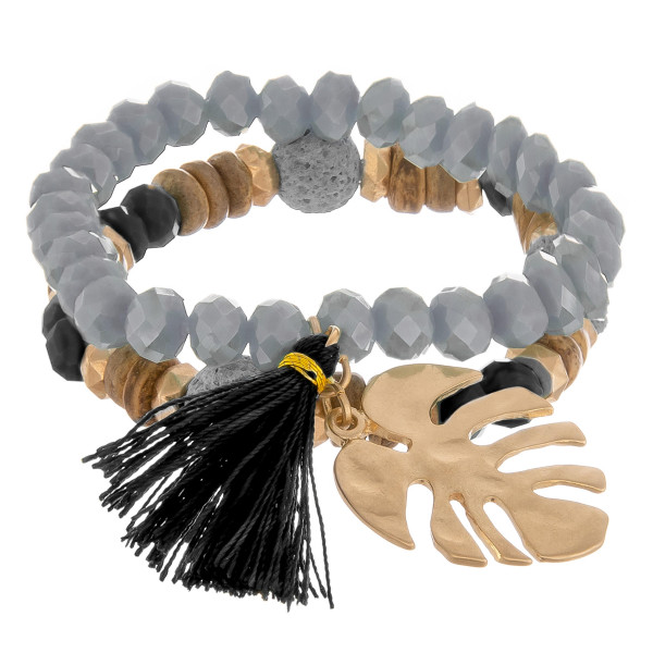 """Layered beaded bracelet with natural stone and leaf with tassel charm. Approximate 6"""" in length."""